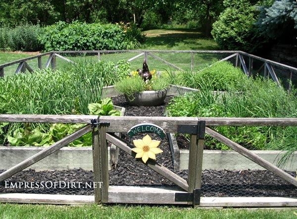 Sunflower welcome sign on garden gate