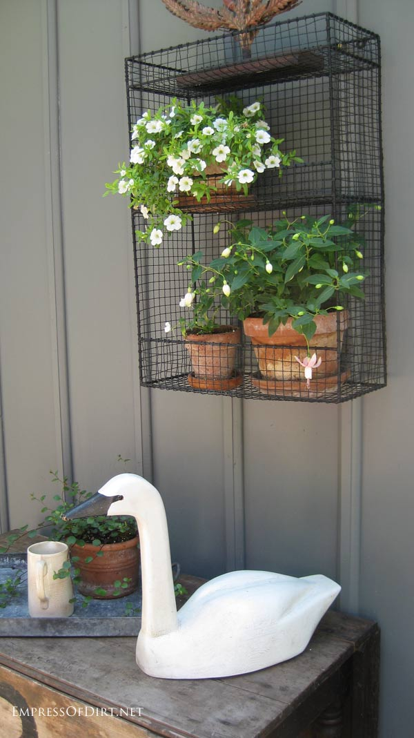 Wooden garden art swan and white flowers