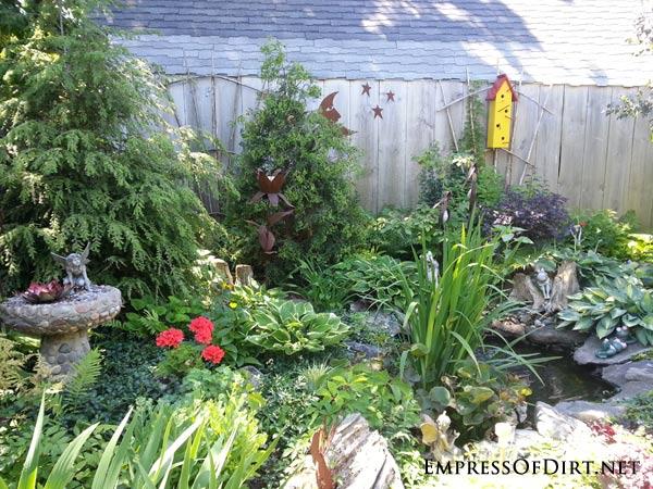 Yellow birdhouse in the garden