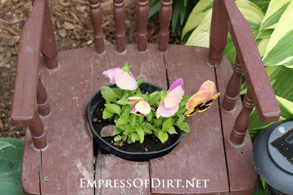 Chair with seat cutout for flower pot: Gallery of garden art chair ideas