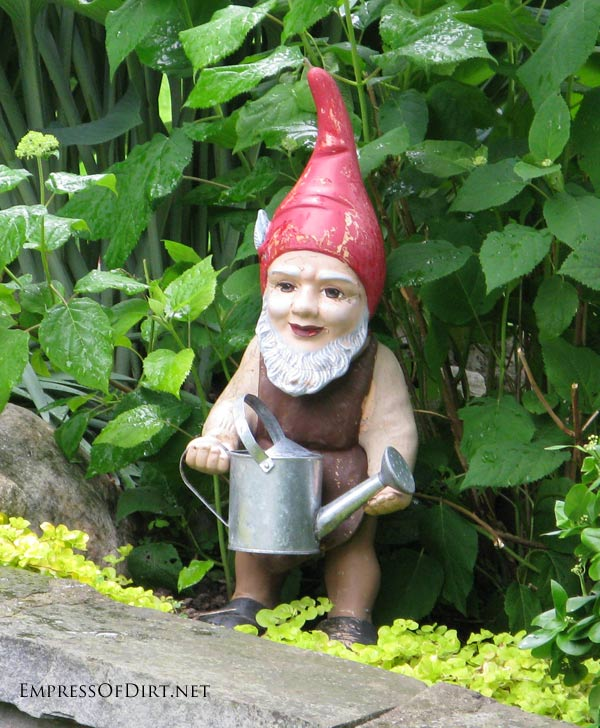 Garden gnome holding watering can