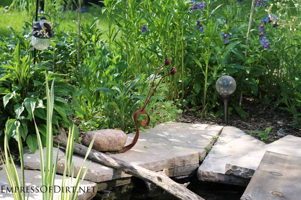 Snail garden art at small pond