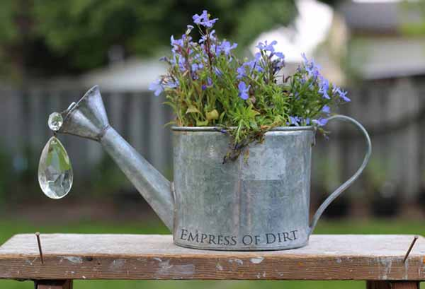Gallery of watering can garden art ideas - use lamp crystals to form water droplets