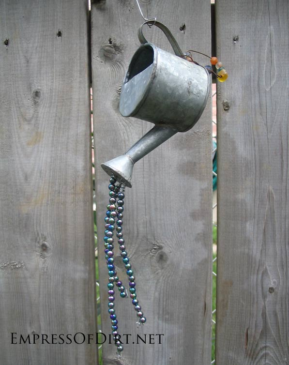 Gallery of watering can garden art ideas - little watering can with beads spilling out