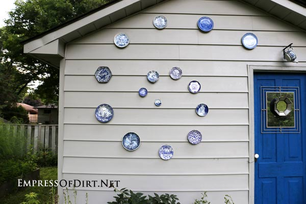 Before & After: Shed Makeover - including plates as outdoor decor