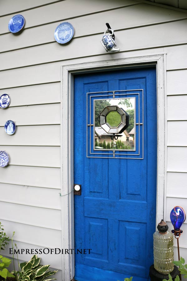 Before & After: Shed Makeover - including plates as outdoor decor and mirrored door