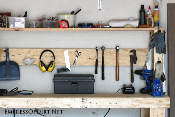 DIY workbench with upper shelf for tool storage | empressofdirt.net