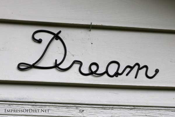 Dream garden art sign on shed wall | empressofdirt.net