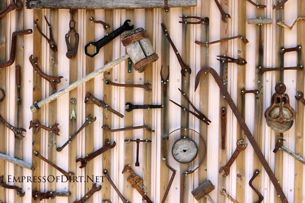 Rusty tools on shed wall at the The Rusty Garden Art Gallery empressofdirt.net.