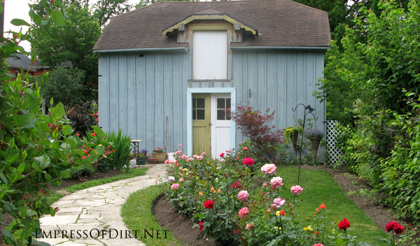 Shed with two different colour doors and rose garden - see more ideas at empressofdirt.net