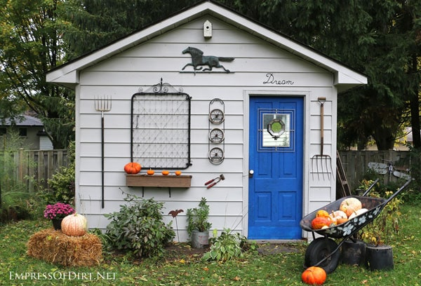Rustic shed with garden junk decor - see more ideas at empressofdirt.net