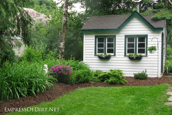 White shed with green trim - see more creative shed ideas at empressofdirt.net