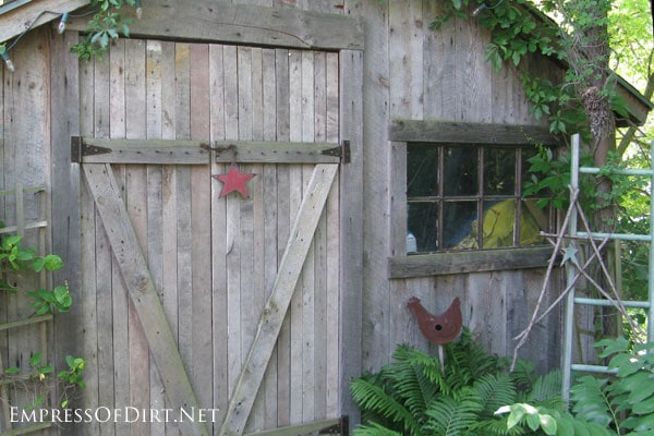 Garden shed with wide barn doors - see more creative shed ideas at empressofdirt.net