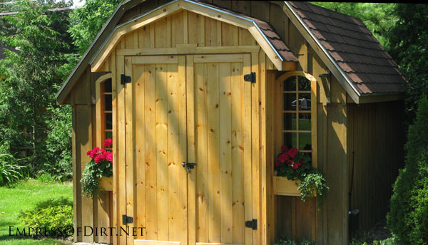 Wooden shed with double doors - see more creative garden shed ideas at empressofdirt.net