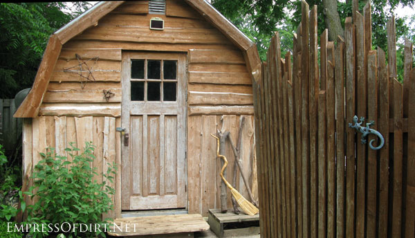 Wooden shed with rustic stars - more creative garden shed ideas at empressofdirt.net