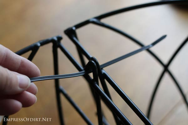 Cable ties joining garden containers together for a DIY sparkling garden orb