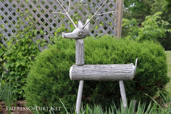 Garden art deer made from logs   15 Creative Folk Art Ideas in the garden at empressofdirt.net