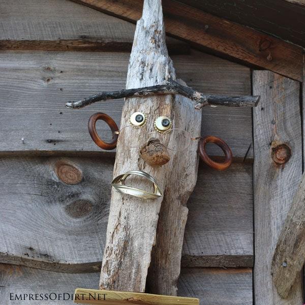 Fun garden art face   15 Creative Folk Art Ideas in the garden at empressofdirt.net