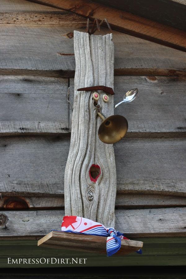 Fun garden art face with trumpet nose  15 Creative Folk Art Ideas in the garden at empressofdirt.net