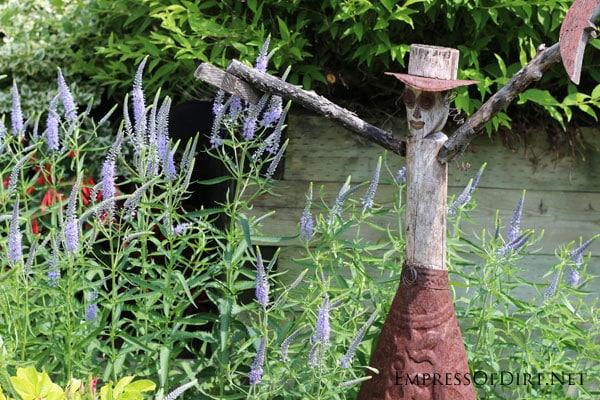 Rustic cowgirl garden junk/art   15 Creative Folk Art Ideas in the garden at empressofdirt.net