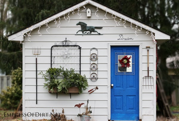 Rustic garden shed decorated for winter