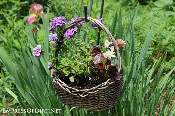 Wicker basket with purple flowers | 21 Gorgeous Flower Planter Ideas