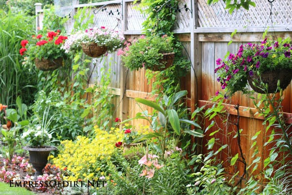 21 gorgeous flower planter ideas empress of dirt - Flower pots to hang on fence ...