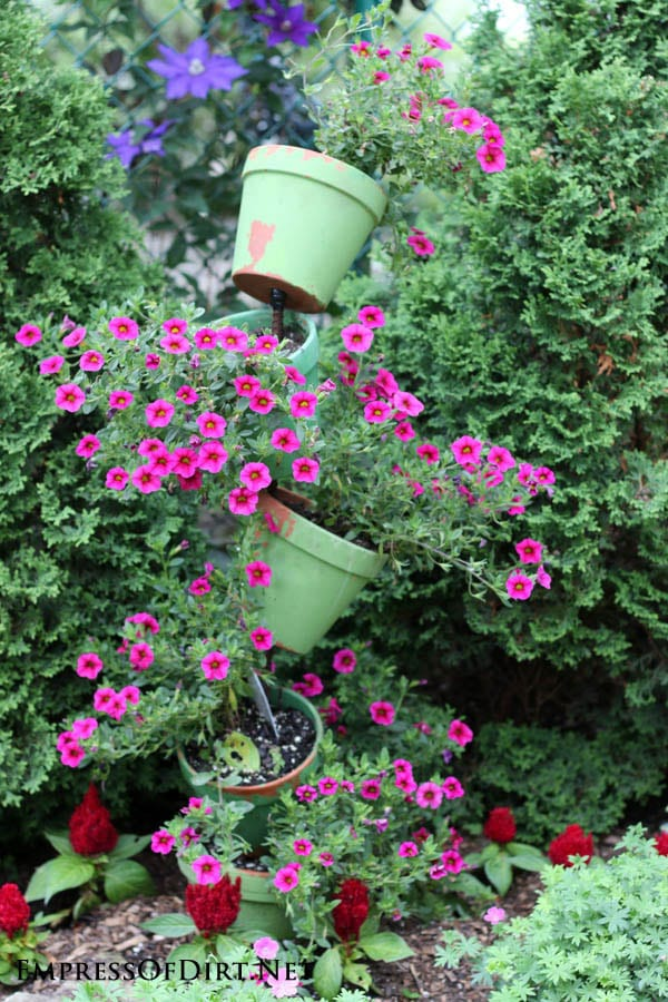 Planter Garden Ideas 21 gorgeous flower planter ideas from home gardens empress of dirt green tipsy pots spilling over with flowers 21 gorgeous flower planter ideas to inspire your workwithnaturefo