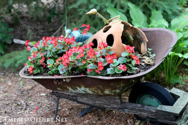 Old wheelbarrow planted with broken strawberry planter | 21 Gorgeous Flower Planter Ideas