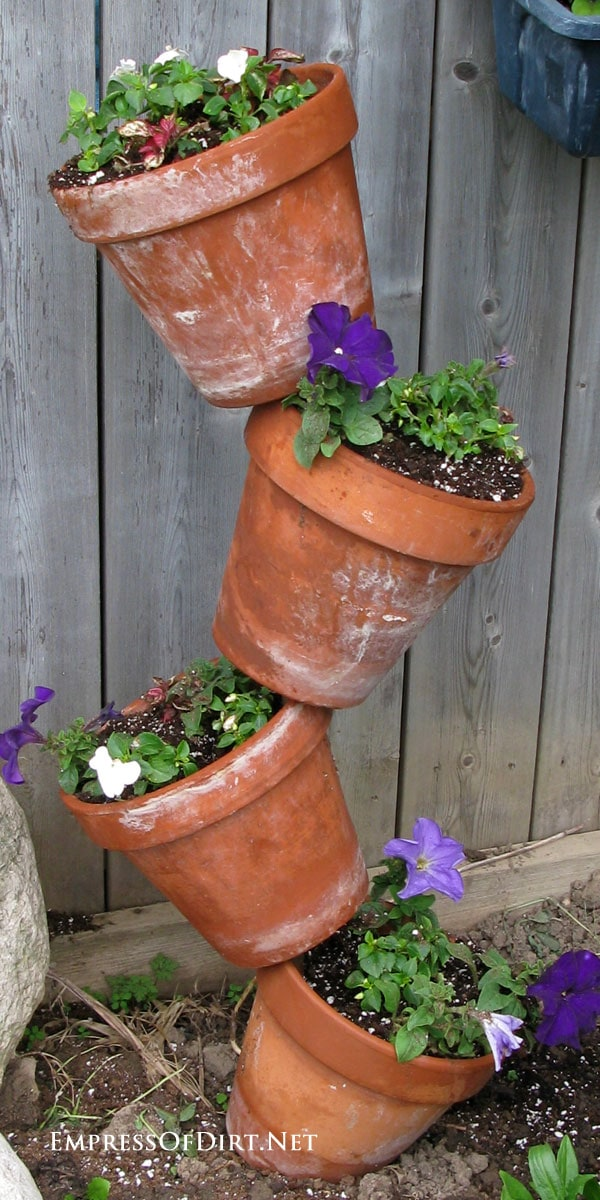 Tipsy Pots Gallery - also known as topsy turvy towers - clay pots with petunias