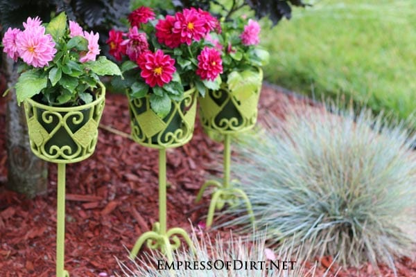 Kick your garden up a notch with these 12 Colourful Garden Ideas at empressofdirt.net. These bright green plant stands add a wonderful pop of colour.