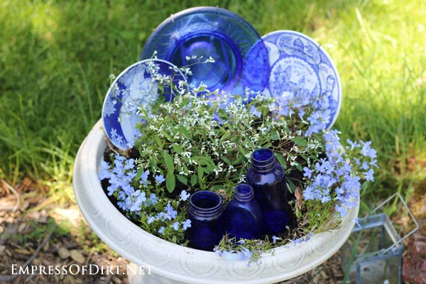 Kick your garden up a notch with these 12 Colourful Garden Ideas at empressofdirt.net. Use old dishes to brighten up a flower planter.