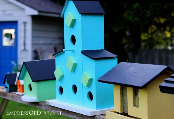 Birdhouses painted in bright colours.