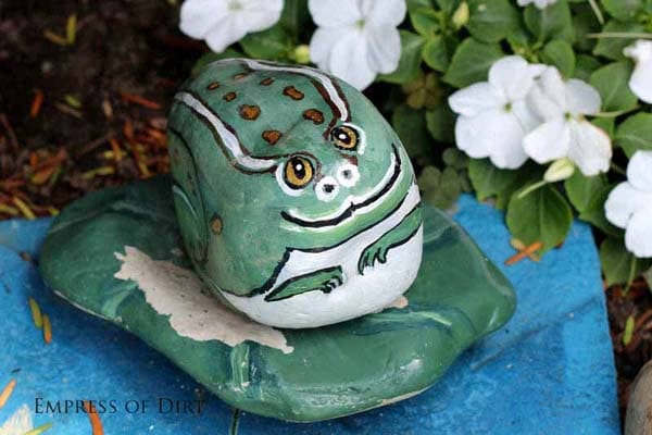 Frog painted on a rock.