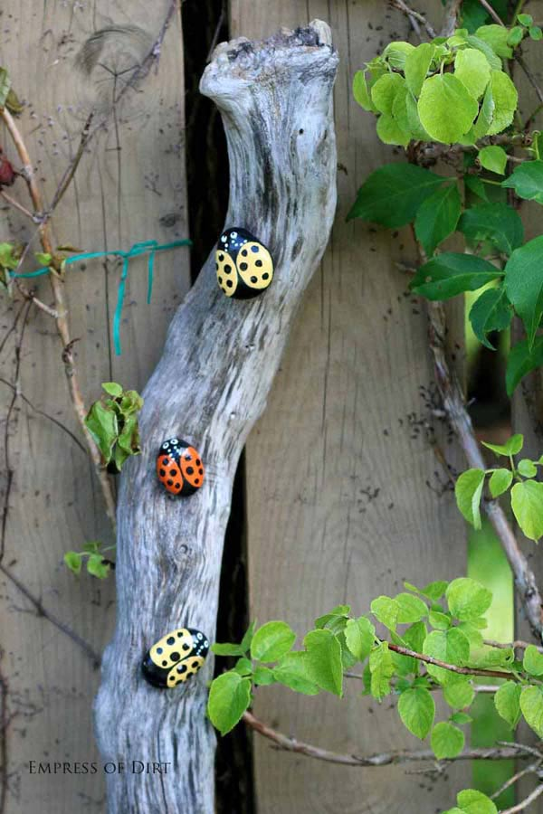 Stone painted to look like ladybugs.