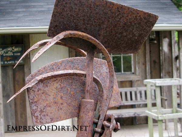 Rustic garden junk tool art in modern Victorian-style kitchen garden. Come see the entire tour!