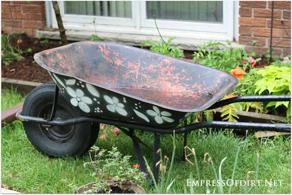 A good, old wheelbarrow can last for years with some rust protection! Add stencils to jazz it up.