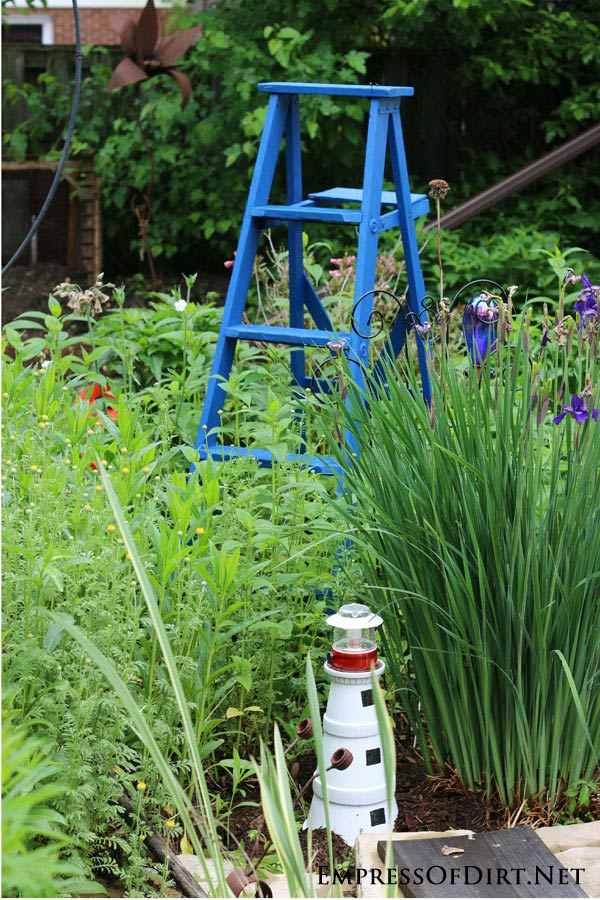 Old painters' ladder painted blue becomes garden art!