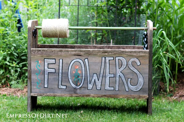 DIY wheelbarrow garden trug made from repurposed wood.