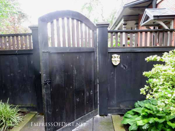 Want to make a grand entrance to your garden? Add a fabulous garden gate! Or turn one into garden art or trellis or whatever you like! This gate is stained black, and provides privacy and nice, wide entry way for bringing supplies into the backyard.