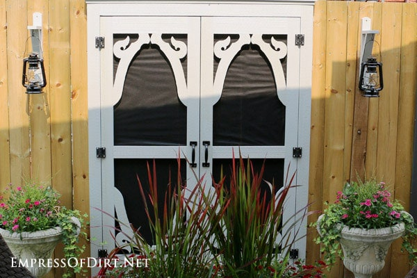 DIY Faux windows and door for fences. Great way to transform plain fences into something wonderful!
