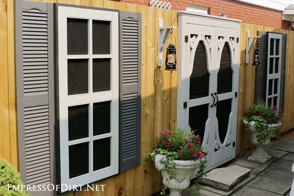 Dress Up a Fence with Faux Windows and Doors - Empress of Dirt