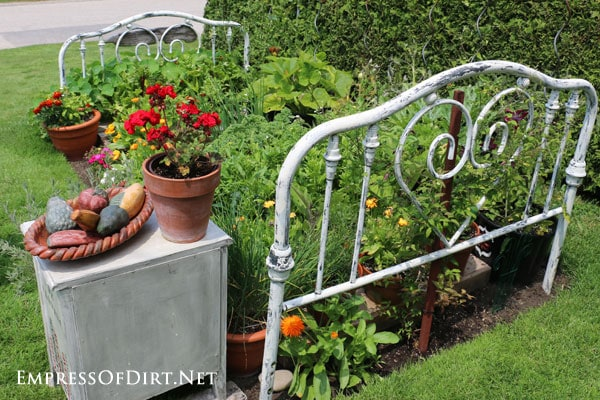 Rear view of old metal bed used in a veggie garden.