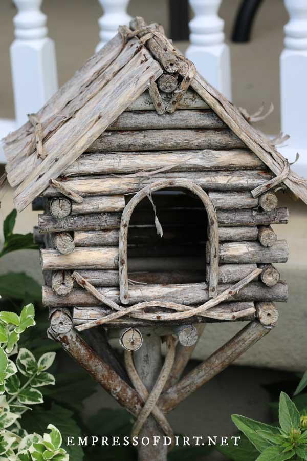 Log cabin style birdhouse.