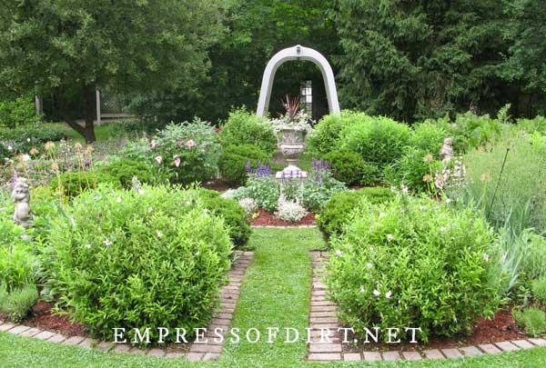 Formal garden with brick edging.