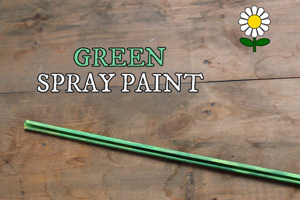 Metal curtain rod painted green to represent a flower stem.