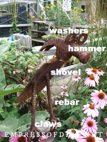 Metal garden art bird made from old tools.
