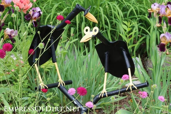 Painted metal garden art bird made from old tools.