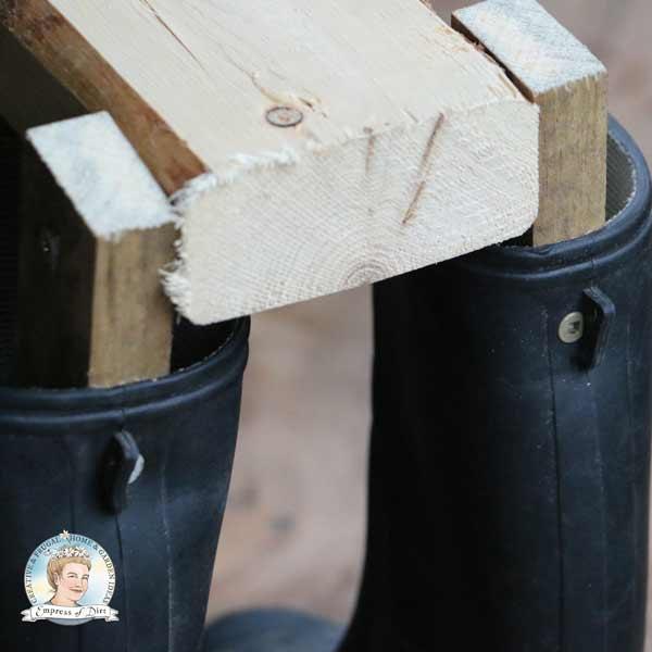 Close up of wood frame for boot dogs.