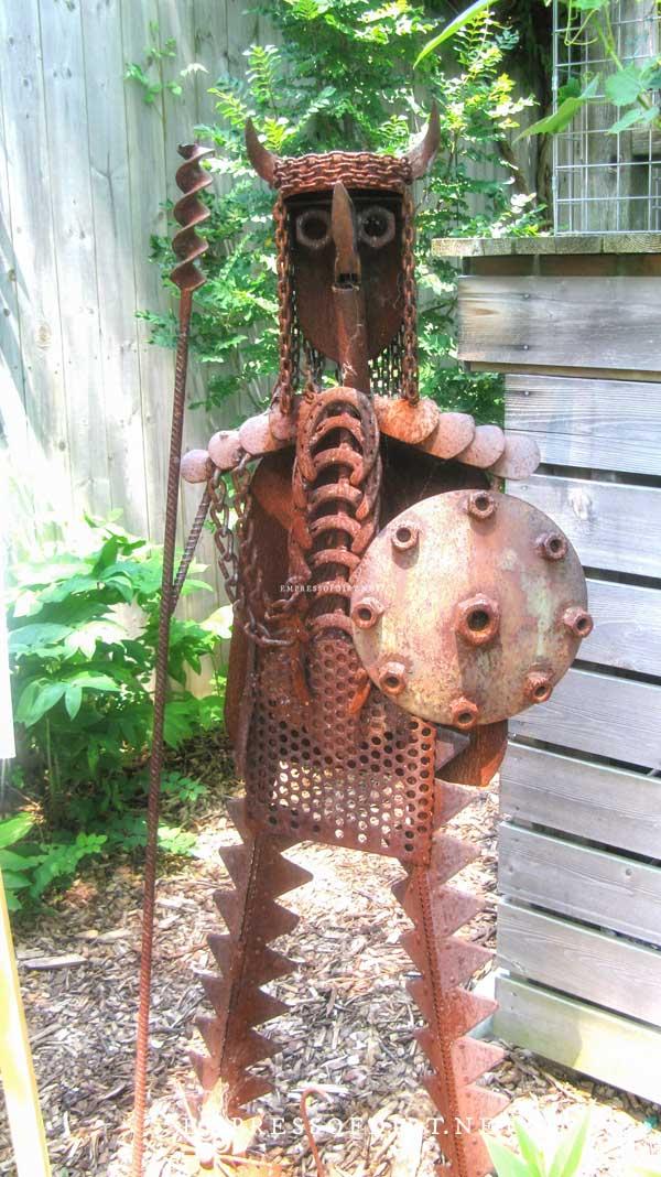 Rusty metal knight garden art statue.